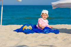 Baby girl beach portrait Stock Photos