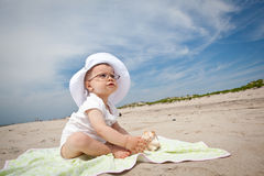 Baby girl at beach Stock Photos