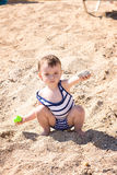 Baby girl on the beach Stock Image