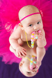 Baby girl with beads Stock Photos