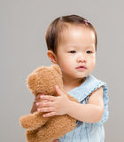 Baby girl with bear Stock Photos