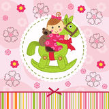 Baby girl with bear on horse Stock Image