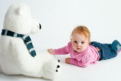 Baby girl with bear toy Royalty Free Stock Images