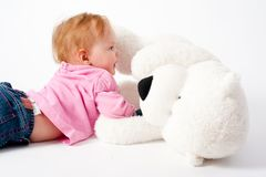Baby girl with bear toy Stock Images