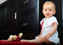 Baby girl and bear toy Stock Photography