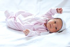 Baby girl on the bed royalty free stock image