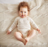 Baby girl on the bed Stock Photos