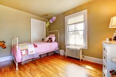 Baby girl bedroom interior with pink bed. Royalty Free Stock Photography