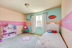 Baby girl bedroom with white bed. Royalty Free Stock Photo