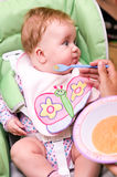 Baby girl being fed. With a spoon Stock Images