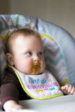 Baby girl being fed. Happy baby girl full of expressions during her feeding from mom royalty free stock photos