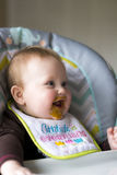 Baby girl being fed. Happy baby girl full of expressions during her feeding from mom royalty free stock image