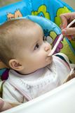 Baby girl being spoon fed Royalty Free Stock Image
