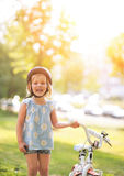 Baby girl with bicycle Royalty Free Stock Photos