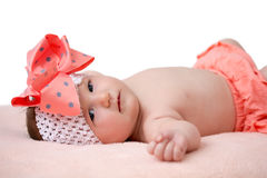 Baby girl with a big bow Stock Photography