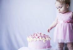Baby girl with a big cake birthday Stock Photography