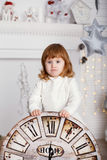 Baby girl with big clock dial Royalty Free Stock Photo