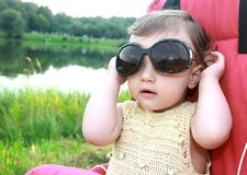Baby girl in big sunglasses royalty free stock images
