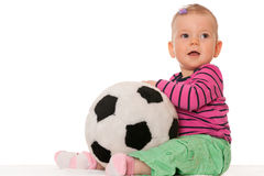 Baby girl with a big toy ball. A cheerful baby girl is holding a big toy ball; isolated on the white background Stock Photography