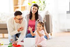 Baby girl with birthday gift and parents at home Royalty Free Stock Photos