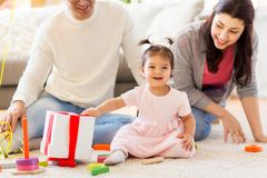 Baby girl with birthday gift and parents at home Royalty Free Stock Photo