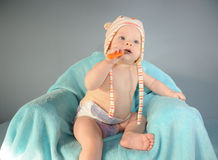 Baby girl bite the orange spoon Royalty Free Stock Photography