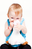 Baby girl biting her toy Royalty Free Stock Photos