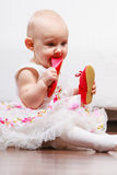 Baby girl biting shoe Stock Photography