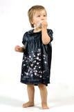 Baby Girl in Black Dress Stock Photos