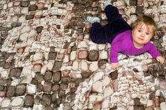 Baby girl on blanket. Cute baby girl lying on a patterned blanket, looking up Stock Photography