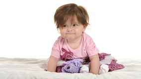 Baby girl on blanket in pink clothes. Portrait of adorable baby girl on blanket in pink clothes on a white background Stock Image