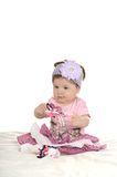 Baby girl on blanket in pink clothes Stock Photo