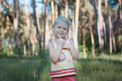 Baby girl blonde in the forest. Royalty Free Stock Photography