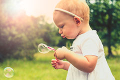 Baby girl blowing bubbles Royalty Free Stock Images