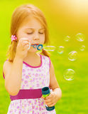 Baby girl blowing soap bubbles Royalty Free Stock Photo