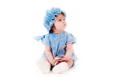Baby girl in a blue dress Stock Photography