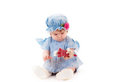 Baby girl in a blue dress Royalty Free Stock Photo