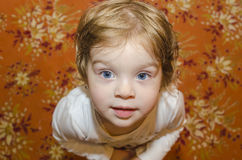 Baby Girl with Blue Eyes. Closeup of baby girl with beautiful blue eyes Stock Photo