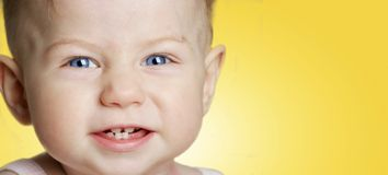 Baby girl with blue eyes smiling Stock Photo