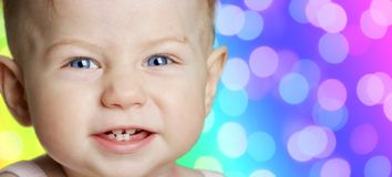 Baby girl with blue eyes smiling royalty free stock image