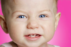 Baby girl with blue eyes smiling Stock Photos
