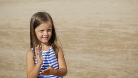 Baby girl blue striped dress dancing. On the sandy beach stock footage