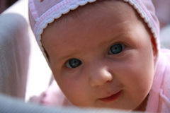 Baby girl with bonnet Stock Image