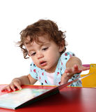 Baby girl with book Royalty Free Stock Photography