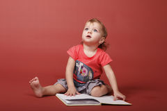 Baby girl with book Royalty Free Stock Image