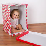 Baby girl in the box Stock Photography