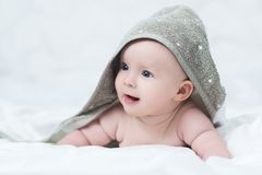 Baby girl or boy after shower with towel on head royalty free stock images