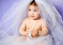 Baby girl. With bridal veil Stock Photography