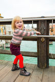 Baby girl on bridge in venice, italy Stock Photo
