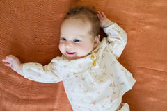 Baby girl in a brown elegant blouse Stock Photography